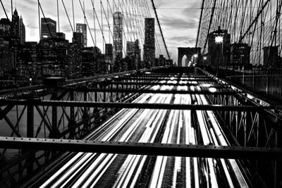 The Manhattan Skyline Rises Above Traffic on the Brooklyn Bridge by Kike Calvo