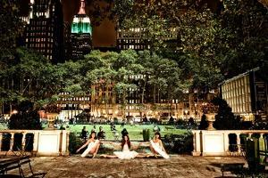 Three Ballerinas in White Tutus Dancing in Bryant Park at Night by Kike Calvo