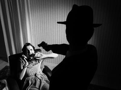 Killer Pointing the Gun at a Terrified Woman-stokkete-Photographic Print
