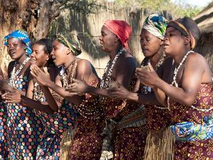 Villagers Dancing in Motion, Kxoe Village, Kwando River Area, Caprivi Strip, Eastern Namibia by Kim Walker