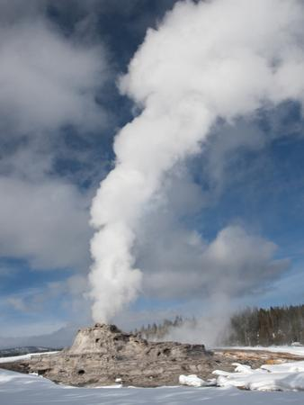 Castle Geyser Erupting in Winter Landscape, Yellowstone National Park, UNESCO World Heritage Site,