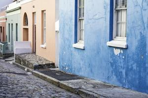 Pastel Colored Homes on Cobblestone Street in Bo-Kaap Residential District by Kimberly Walker