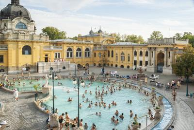 People Soaking and Swimming in the Famous Szechenhu Thermal Bath, Budapest, Hungary