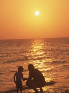 Father and Son on Duck Harbor Beach, Cape Cod, MA by Kindra Clineff
