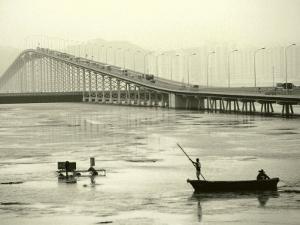 Fishing Near Bridge, Macau, China by Kindra Clineff