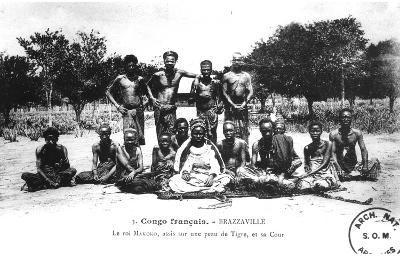 King Makoko, Seated on a Tiger Skin, and His Court, in Brazzaville, French Congo--Photographic Print