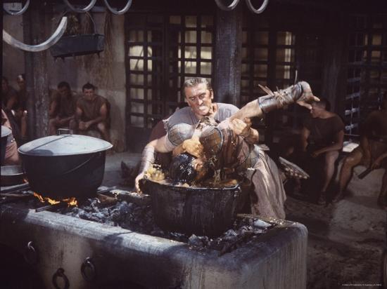"Kirk Douglas Dunking Enemy's Head in Giant Cook Pot in Scene From Stanley Kubrick's ""Spartacus""-J^ R^ Eyerman-Premium Photographic Print"