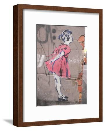 Kiss-Banksy-Framed Art Print