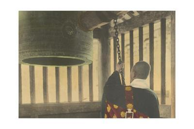 A Buddhist Priest Strikes a Temple Bell