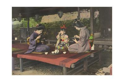 Two Japanese Women and a Young Girl Enjoy Tea and Snacks