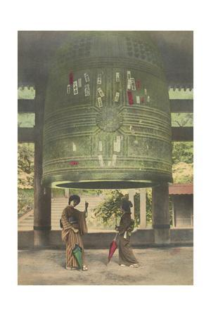 Two Women Stand Below a Giant Bell in the Chion-In Temple of Kyoto
