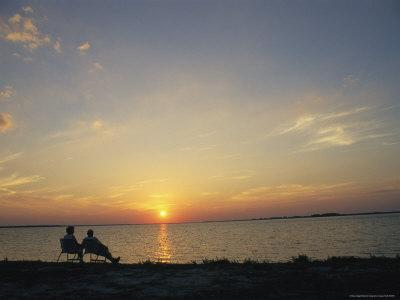 Elderly Couple Enjoy Watching a Sunset