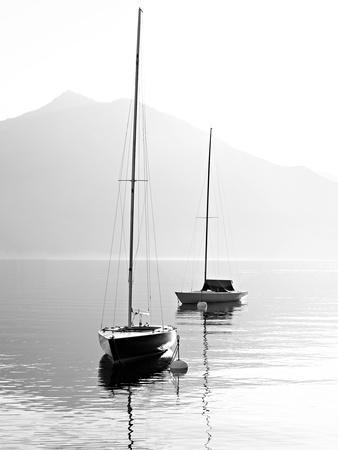 Two Sail Boats in Early Morning on the Mountain Lake. Black and White Photography. Salzkammergut, A