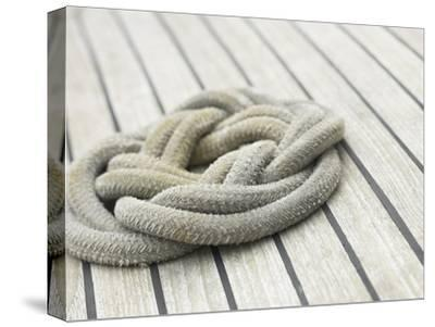 Knot of Rope on Wooden Boat Deck