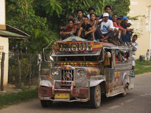 Jeepney Truck with Passengers Crowded on Roof, Coron Town, Busuanga Island, Philippines by Kober Christian