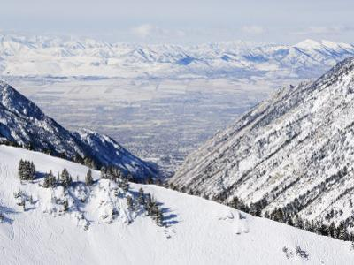 Salt Lake Valley and Fresh Powder Tracks at Alta, Alta Ski Resort, Salt Lake City, Utah, USA by Kober Christian