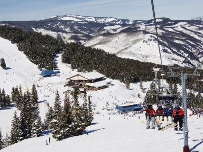 Skiers Being Carried on a Chair Lift to the Back Bowls of Vail Ski Resort, Vail, Colorado, USA