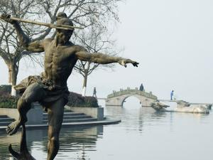 Statue of a Spear Fisherman in the Waters of West Lake, Hangzhou, Zhejiang Province, China by Kober Christian