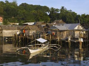 Stilt Houses and Catamaran Fishing Boat, Coron Town, Busuanga Island, Palawan Province, Philippines by Kober Christian
