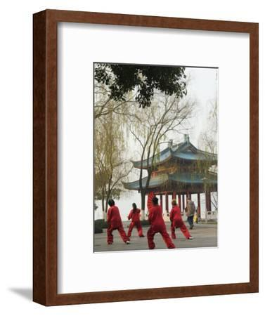 Women Practising Tai Chi in Front of a Pavilion on West Lake, Hangzhou, Zhejiang Province, China