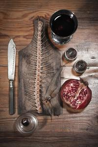 A Still Life Featuring a Fish Skeleton, Pomegranate and Red Wine by Komar