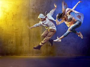 Stylish Dancers Dancing in a Concrete Place by Konrad B?k
