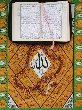 https://imgc.artprintimages.com/img/print/koran-rosary-and-allah-calligraphy-paris-france-europe_u-l-p910yb0.jpg?p=0
