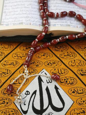 https://imgc.artprintimages.com/img/print/koran-rosary-and-allah-calligraphy-paris-france-europe_u-l-p9ebdm0.jpg?p=0