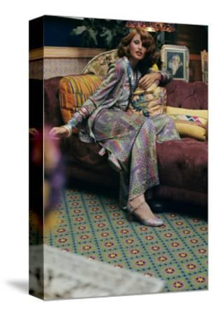 Seated Model Wearing a Lurex Suit in a Colorful Mosaic Print