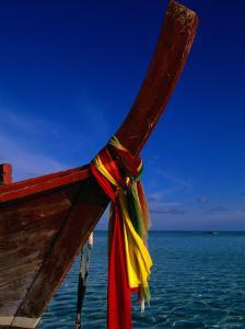 Bow of Traditional Longtail Boat with Coloured Cloth to Appease Sea Spirits, Thailand by Kraig Lieb