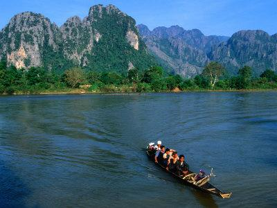 Longboat Crossing Nam Song from Limestone Formations with Honeycomb Caves, Vang Vieng, Laos