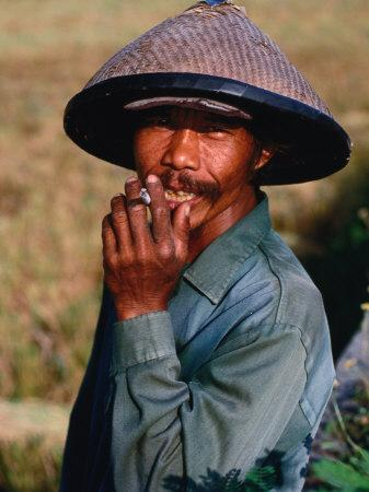 Portrait of a Farm Worker Smoking a Cigarette, Looking at Camera, Ubud, Indonesia