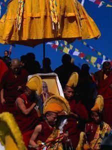 Tibetan Lamas Carrying Photo of Dalai Lama During Tibetan New Years Festival, Nepal by Kraig Lieb