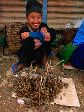 White Hmong Girl with Dried Berries, Looking at Camera, Laos