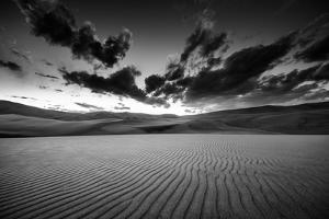 Dramatic Sky over Desert Dunes Black and White Landscapes Photography by Kris Wiktor