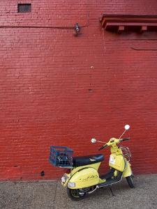 A Yellow Motor Scooter Against a Red Wall in Little Five Points by Krista Rossow