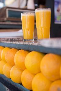 Fresh Squeezed Orange Juice and Oranges at a Stall in Jemaa El-Fnaa by Krista Rossow