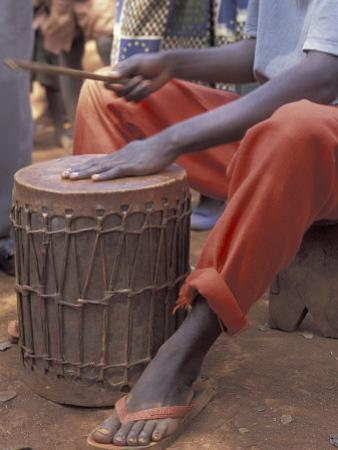 Playing a Congolese Drum in a Congolese Refugee Camp, Tanzania