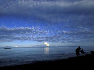 Silhouetted Woman on Lake Tanganyika, Tanzania by Kristin Mosher
