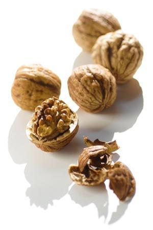 Five Walnuts, Opened and Unopened, on White Background by Kröger and Gross
