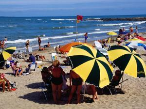 Beach Umbrellas and People on Playa el Emir in Summer, Punta del Este, Maldonado, Uruguay by Krzysztof Dydynski