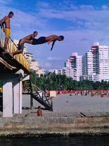 Boys Jumping from Bridge in El Rodadero, Seaside Suburb of Santa Marta, Colombia by Krzysztof Dydynski