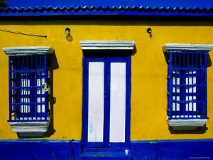 Brightly-Painted House on Main Street, Los Puertos de Altagracia, Zulia, Venezuela by Krzysztof Dydynski