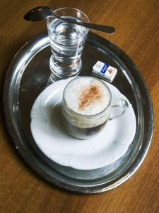 Coffee, Traditionally Served on Oval Metal Tray with a Glass of Water by Krzysztof Dydynski