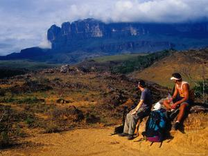 Hikers Taking Break on Hike to Top of Roraima, in Background, Roraima, Bolivar, Venezuela by Krzysztof Dydynski