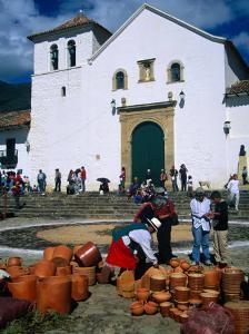 Market on Plaza Mayor with Parish Church in Background, Villa De Leyva, Boyaca, Colombia by Krzysztof Dydynski