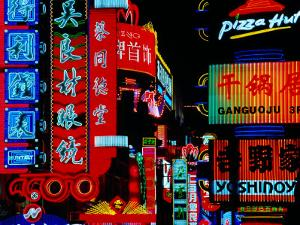 Neon Signs Along Nanjing Donglu Shopping Street, Shanghai, China by Krzysztof Dydynski