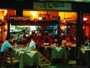 Parrila Type Restaurant in Mercado del Puerto, Montevideo, Uruguay by Krzysztof Dydynski