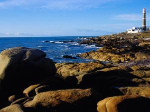 Rocky Coastline and Lighthouse, Cabo Polonio Forest Park, Rocha, Uruguay by Krzysztof Dydynski