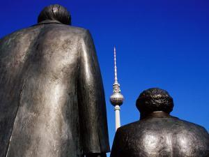 Statues of Karl Marx, Friedrich Engels with Television Tower in Background, Berlin, Germany by Krzysztof Dydynski